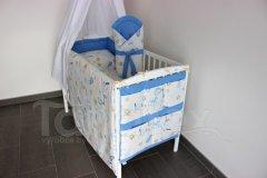 Čáp s miminkem s modrou